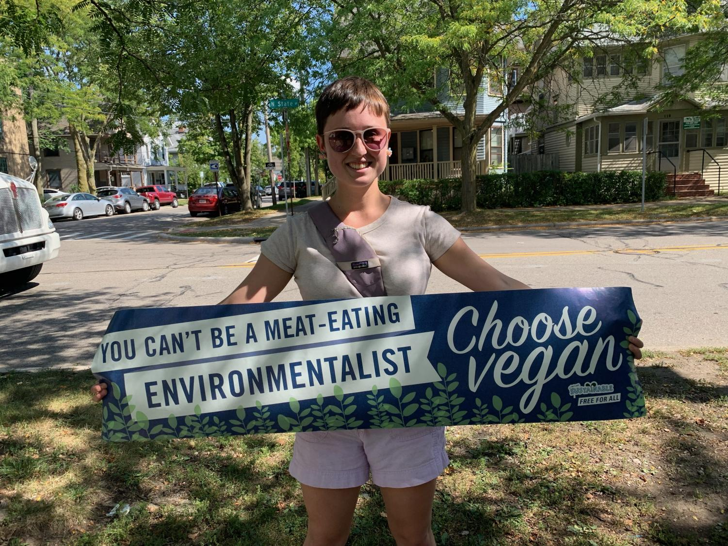 Jacqueline Webster proudly holds up the sign she brought to the Climate Strike.