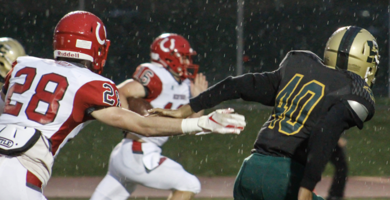 Bedford's Christian Brown runs for a touchdown to make it 14-0 in the middle of the first quarter.