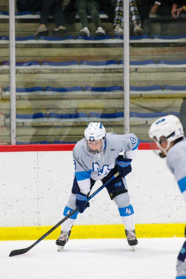 Noah+Bradburn+lines+up+for+a+face-off+against+Father+Gabriel+Richard+High+School+during+his+senior+year+on+the+Skyline+hockey+team.