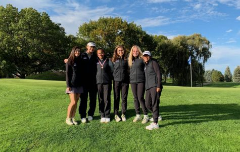 The Pioneer golf team poses for a photo on the 18th green following the award ceremony. They were awarded 8th place and Amaya Melendez finished tied for 9th.