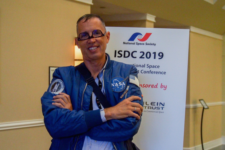 Mongo in his signature outfit at the annual International Space Development Conference run by the National Space Society. He finds that his upside down glasses easily catch the attention of the students he works with.