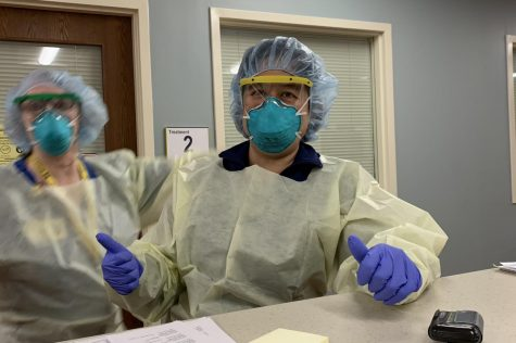 Dr. Grace Jenq gives an optimistic thumbs up to the camera wearing her PPE (Personal Protective Equipment). Soon after this picture was taken, she would become head of Phase 5 Post Acute Care at the Michigan Medicine field hospital.