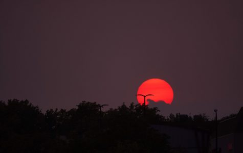 Photo courtesy of Jon Thomas-Palmer. The view of the red sunset from Veteran's Memorial Park.