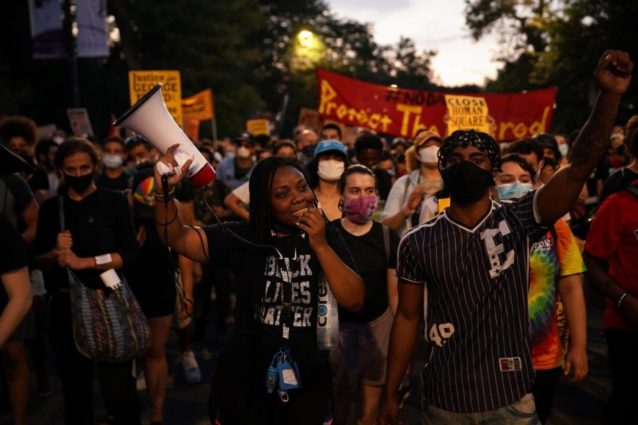 Activists march through Chicago's North Lawndale neighborhood during a rally to defund police on Friday, July 24, 2020. (E. Jason Wambsgans/Chicago Tribune/TNS)