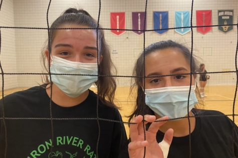This is a photo taken at a Huron High School Volleyball practice. For the safety of ourselves and our community, athletes play in masks. How have athletics changed in the middle of a pandemic, and is it safe to play?