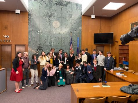 The CHS Mock Trial Team poses in the Washtenaw County Courthouse after their 2020 Washtenaw Regionals Competition. Both the CHS teams won Regionals that year and were slated to compete at the state competition, but COVID-19 resulted in the tournament