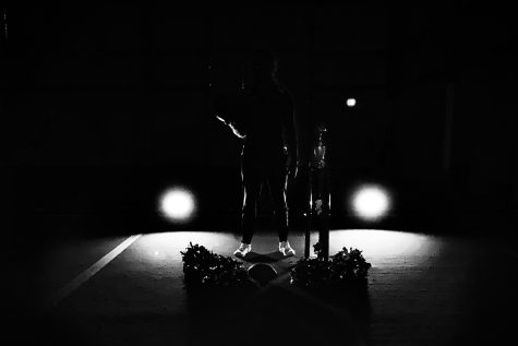 I went to my gym early and brought some lights  for home and took picture with my sideline cheer poms on the ground and me holding a basketball to represent the sports I played for.