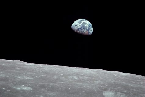 "Earthrise, the photo of the Earth rising above the Lunar surface, was taken by astronaut Bill Anders on Dec. 24, 1968 during the Apollo 8 mission. ""We set out to explore the moon and instead discovered the Earth,"" Anders said."