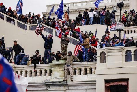 Pro-Trump supporters storm the U.S. Capitol following a rally with President Donald Trump on Wednesday, Jan. 6, 2021. (Samuel Corum/Getty Images/TNS)