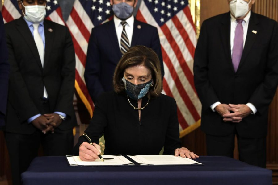 Speaker of the House Nancy Pelosi, D- Calif., signs the article of impeachment against President Donald Trump during an engrossment ceremony on Capitol Hill in Washington, D.C., on Wednesday, Jan. 13, 2021. (Yuri Gripas/Abaca Press/TNS)