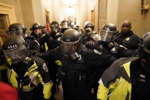 WASHINGTON, DC - JANUARY 06: Riot police clear the hallway inside the Capitol on Wednesday, Jan. 6, 2021 in Washington, DC. (Kent Nishimura / Los Angeles Times)