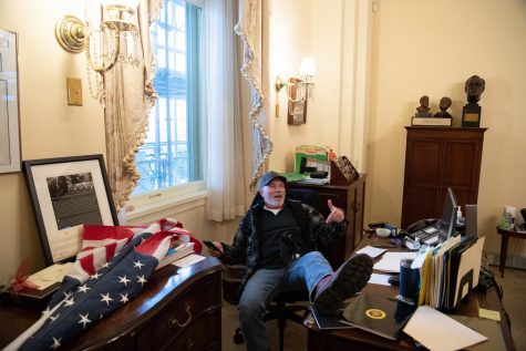 A supporter of President Donald Trump sits inside the office of U.S. Speaker of the House Nancy Pelosi as he protests inside the U.S. Capitol in Washington, D.C., on Jan. 6, 2021. Demonstrators breached security and entered the Capitol as Congress debated the a 2020 presidential election Electoral Vote Certification. (Saul Loeb/AFP/Getty Images/TNS)