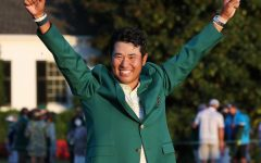 Hideki Matsuyama is presented the green jacket as he celebrates winning the Masters on Sunday, April 11, 2021, at August National Golf Club in Augusta, Georgia. (Curtis Compton/Atlanta Journal-Constitution/TNS)