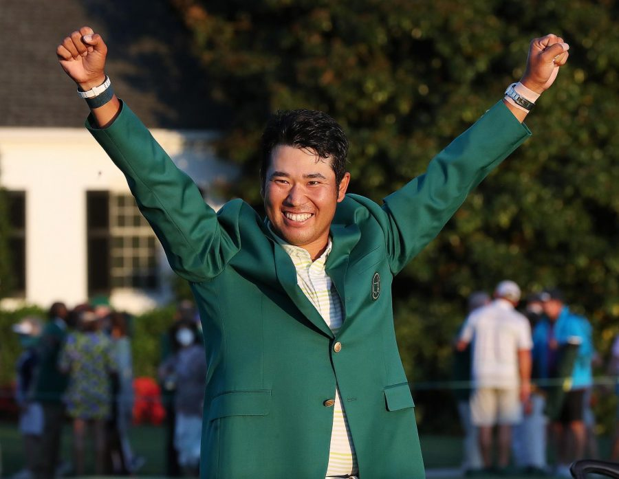 Hideki+Matsuyama+is+presented+the+green+jacket+as+he+celebrates+winning+the+Masters+on+Sunday%2C+April+11%2C+2021%2C+at+August+National+Golf+Club+in+Augusta%2C+Georgia.+%28Curtis+Compton%2FAtlanta+Journal-Constitution%2FTNS%29