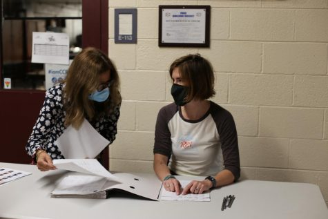 Gretchen Eby and Courtney Kiley worked during the week to check students in for testing.