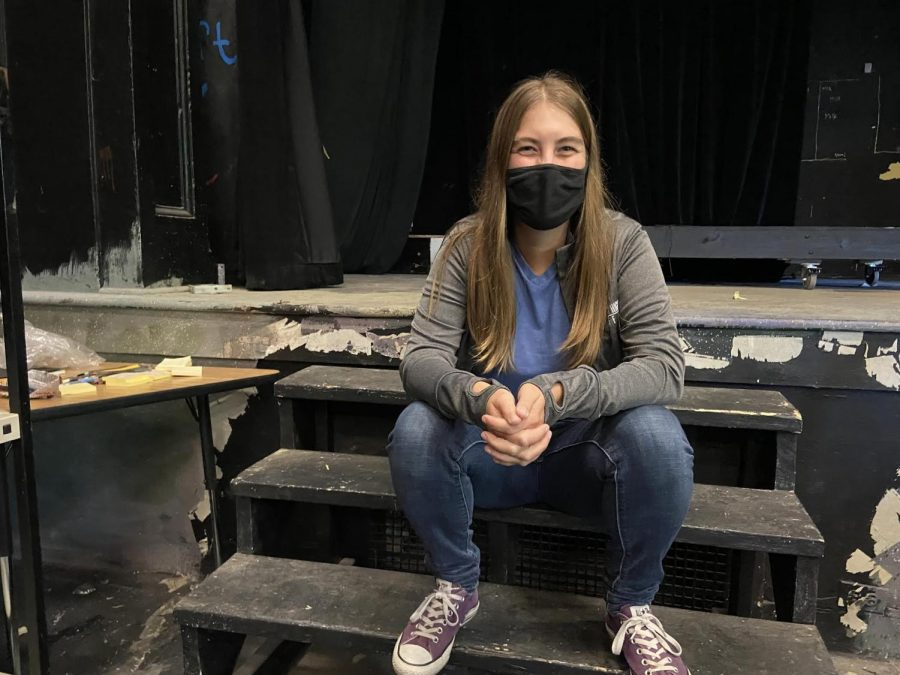 Sarah Hechler sits on the steps of the stage in Craft Theater. As the new tech director of CET, she has spent a lot of time in Communitys black box theater.