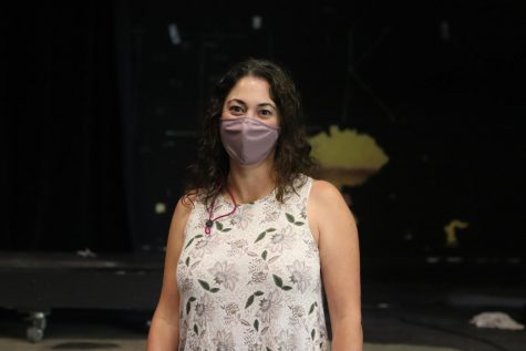 Emily Wilson-Tobin presents herself as the new director of CET on the stage of the Craft Theater.